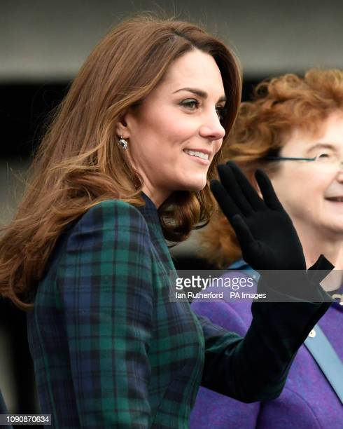 The Duchess of Cambridge known as the Duchess of Strathearn in Scotland waves to the crowd as she arrives at the VA Dundee Scotland's first design...