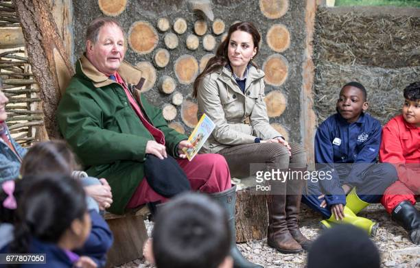The Duchess of Cambridge listens to children author Michael Morpurgo read one of his stories during a visit to a 'Farms for Children' farm on May 3...