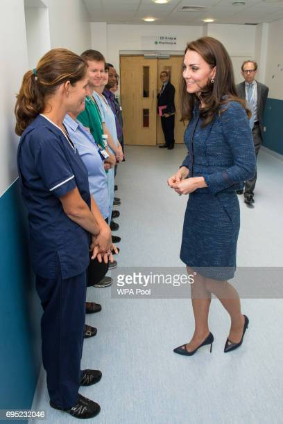 The Duchess of Cambridge speaks to Team Leader Ellen during a visit to Kings College Hospital in south London where she met staff and patients who...