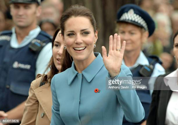 The Duchess of Cambridge waves during a Wreath-laying and Commemoration ceremony at the War Memorial in Seymour Square, Blenheim, during their...