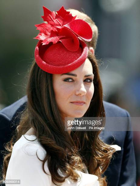 The Duchess of Cambridge wears a white suit and hat featuring Red Maple leaves after arriving with the Duke of Cambridge at the Canadian Parliament...