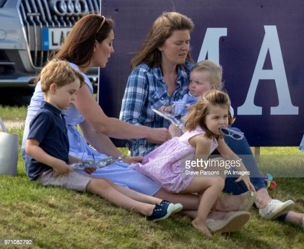 The Duchess of Cambridge with Prince George and Princess Charlotte as her husband the Duke of Cambridge takes part in the Maserati Royal Charity Polo...