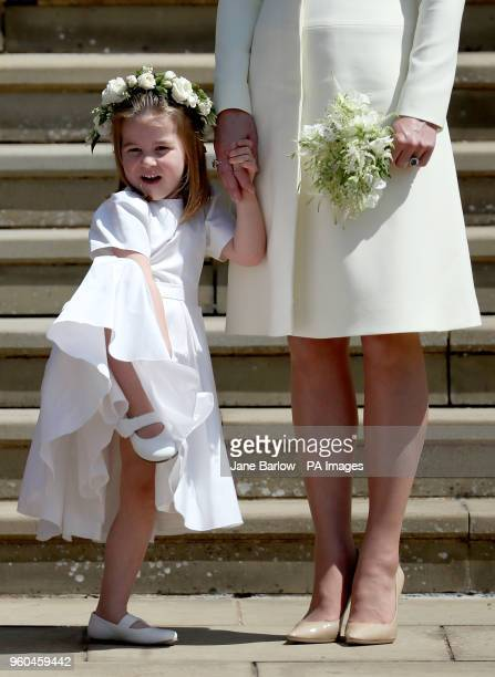The Duchess of Cambridge with Princess Charlotte leave St George's Chapel in Windsor Castle after the wedding of Prince Harry and Meghan Markle