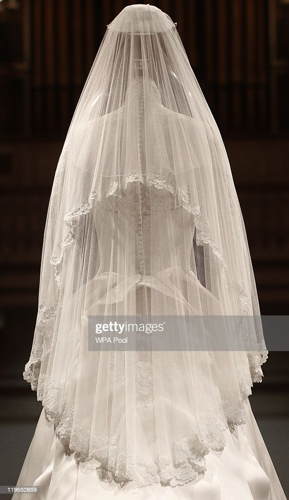 The Duchess of Cambridge's wedding dress, designed by Sarah Burton for Alexander McQueen, is photographed before it goes on display at Buckingham Palace during the annual summer opening on July 20, 2011 in London, England. The Duchess of Cambridge's dress featured lace appliqué floral detail and was made of ivory and white satin gazar with a 9ft train. It was worn her wedding day on April 29 to Prince William, Duke of Cambridge.