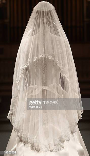 The Duchess of Cambridge's wedding dress designed by Sarah Burton for Alexander McQueen is photographed before it goes on display at Buckingham...