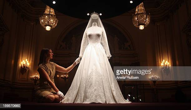 The Duchess of Cambridge's wedding dress designed by Sarah Burton for Alexander McQueen goes on display at Buckingham Palace before the annual summer...