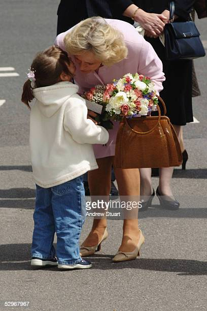 The Duchess of Cornwall accepts a bouquet of flowers from Emily Forrester as she undertakes her first solo engagement visiting Southampton Hospital's...