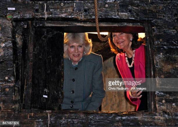 The Duchess of Cornwall and Queen Silvia of Sweden, peer through a gun turret, during a visit to the warrior ship Vasa, the world's last surviving...