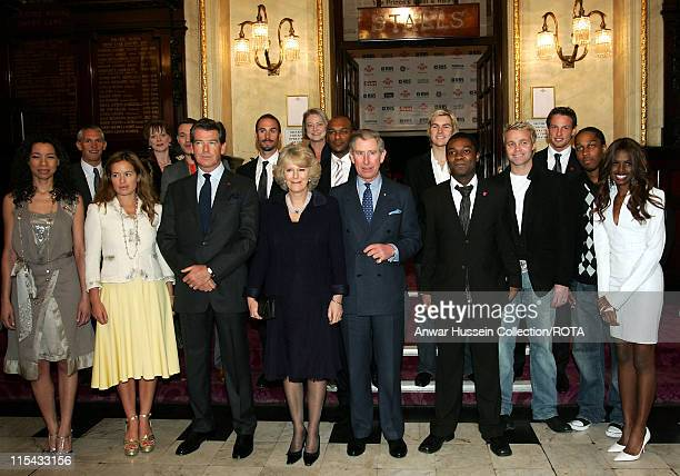 TRH The Duchess of Cornwall and The Prince of Wales pose with Prince's Trust Ambassadors as they arrive at the Theatre Royal Drury Lane in London to...