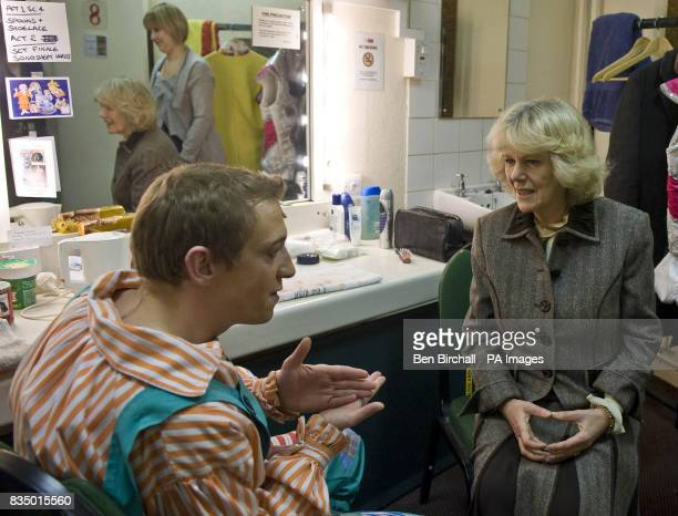 The Duchess of Cornwall chats to Jack and the Beanstalk pantomime cast member Jon Monie in his dressing room during a visit to the Theatre Royal in...