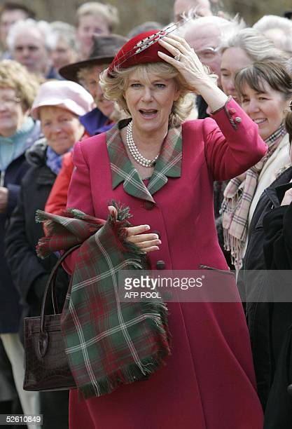 The Duchess of Cornwall holds on to her hat outside Crathie Parish Church in Aberdeenshire 10 April 2005 in her first public engagement since...