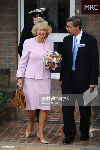 The Duchess of Cornwall leaves the MRC Epidemiology Resource Centre escorted by Professor Cyrus Cooper as part of her first solo engagement visiting...