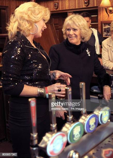 The Duchess of Cornwall meets actors Beverley Callard who plays landlady Liz McDonald during a visit to the the Rovers Return during her visit to the...
