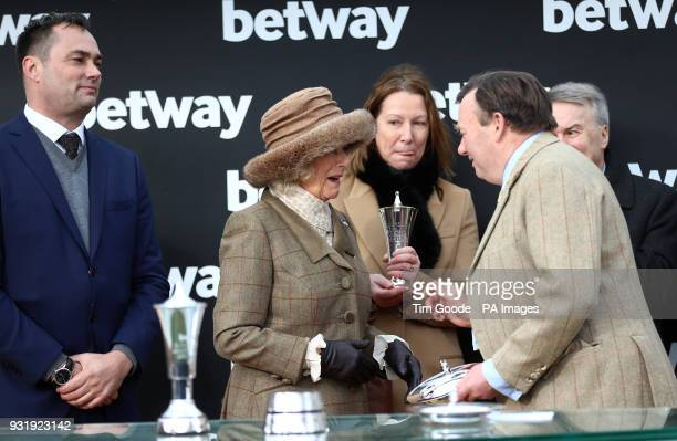 The Duchess of Cornwall presents the trophy to Trainer Nicky Henderson after winning the Betway Queen Mother Champion Chase during Ladies Day of the...