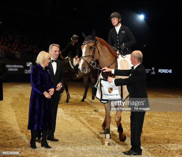 The Duchess of Cornwall presents to the Great Britain's Laura Renwick riding Top Dollar VI after winning the Cayenne Puissance during day three of...