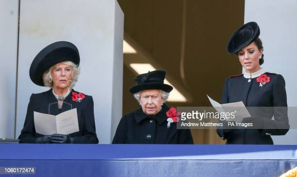 The Duchess of Cornwall Queen Elizabeth II and the Duchess of Cambridge on a balcony during the remembrance service at the Cenotaph memorial in...