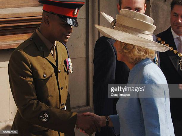 The Duchess of Cornwall shakes hands with Private Johnson Beharry VC as TRH The Prince of Wales the President of The Victoria Cross and George Cross...