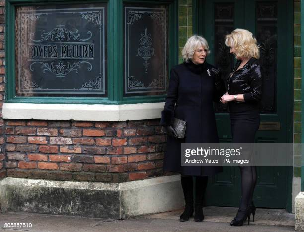 The Duchess of Cornwall speaks with Beverley Callard who plays the role of landlady Liz McDonald as they leave the Rovers Return Pub during her visit...