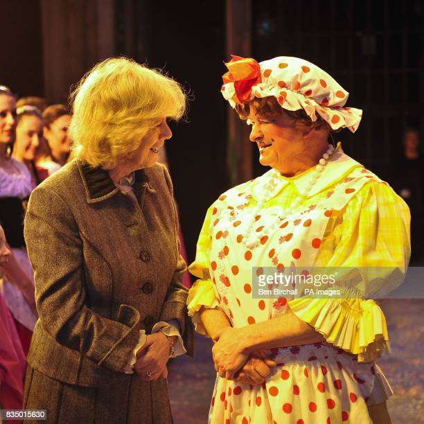 The Duchess of Cornwall speaks with Dame Trott from pantomime Jack and the Beanstalk played by Chris Harris who also directs the panto during a visit...