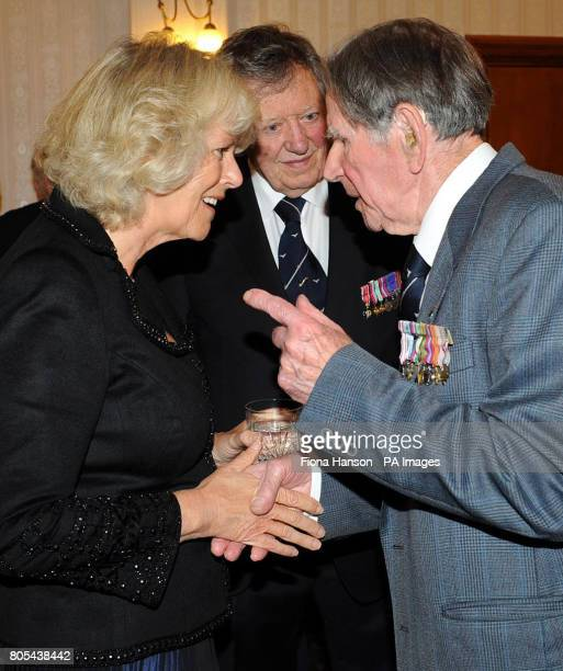 The Duchess of Cornwall speaks with RAF Ex-Prisoner of War, Lewis Hurd and Air Commodore Charles Clarke at RAF Henlow, Bedfordshire where she...