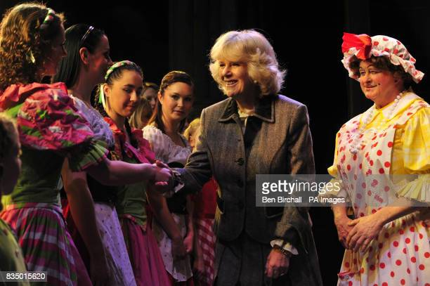 The Duchess of Cornwall speaks with young members from the Dorothy Coleborn School of Dance who also appear in the pantomime Jack and the Beanstalk...