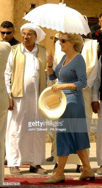 The Duchess of Cornwall takes shade under a parasole in the western Egyptian desert town of Siwa Thursday March 23 2006 As temperatures hit the...