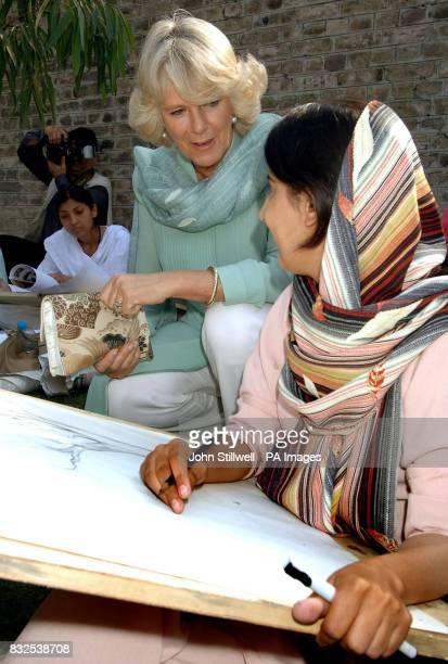 The Duchess of Cornwall talks to a student at the Fatima Jinnah college in Rawalpindi Pakistan