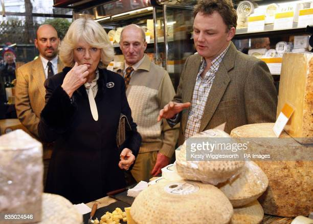The Duchess of Cornwall tastes a cheese during a visit to cheese seller Paxton and Whitfield in central London