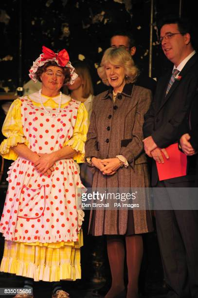 The Duchess of Cornwall watches a performance of the pantomime Jack and the Beanstalk from the stage wings during a visit to the Theatre Royal in Bath