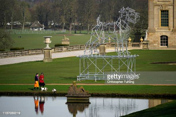 The Duchess of Devonshire and exhibition curator Alex Hodby view 'Dog Scaffolding Sculpture' an eight metre high sculpture of a dog created from...