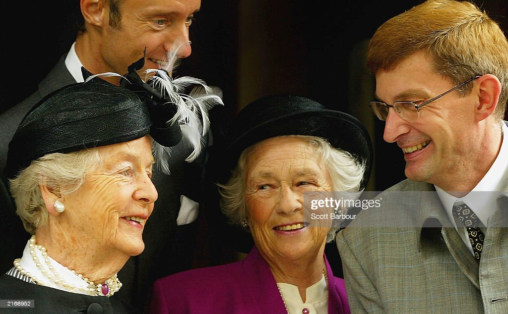 The Duchess of Devonshire, designer Ian Garlent, Mrs J Enoch Powell and Hardy's partner David Freeman talk as they arrive at the Service of Thanksgiving to Celebrate the Life and Work of Sir Hardy Amies July 17, 2003 in London. The memorial service was held for Hardy who was the Queen's dressmaker since 1951. Among his other clients were Diana, Princess of Wales, Vivien Leigh and Lady Diana Cooper, but it is for his royal designs that he is best remembered. He had been retired for only a matter of months before his death, aged 93 in March 2003.