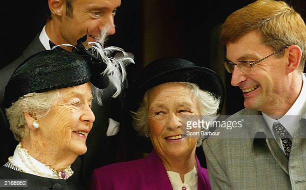 The Duchess of Devonshire, designer Ian Garlent, Mrs J Enoch Powell and Hardy's partner David Freeman talk as they arrive at the Service of...