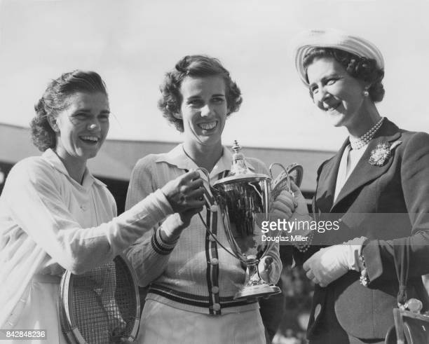 The Duchess of Kent presents the trophy to American tennis players Shirley Fry and Doris Hart after they beat Louise Brough and Margaret Osborne...
