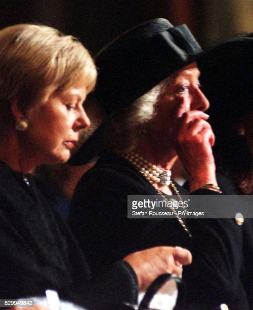 The Duchess of Kent sits beside Frances ShandKydd mother of Diana Princess of Wales who clearly overcome by emotion wipes a tear from her eye during...