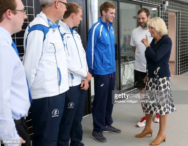 The Duchess of Rothesay Chancellor of Aberdeen University with swimming Coach Gordon Glass with Scottish Commonwealth Games Swimmer Robbie Renwick...