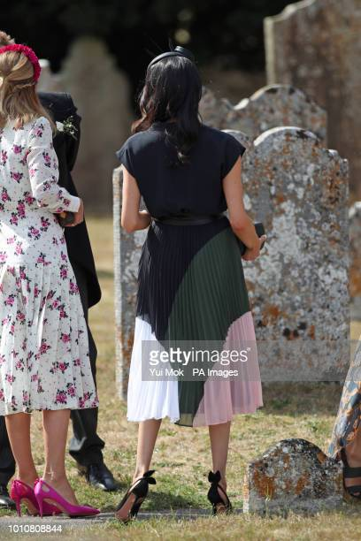 The Duchess of Sussex arrives to attend the wedding of Charlie van Straubenzee and Daisy Jenks at St Mary the Virgin Church in Frensham Surrey