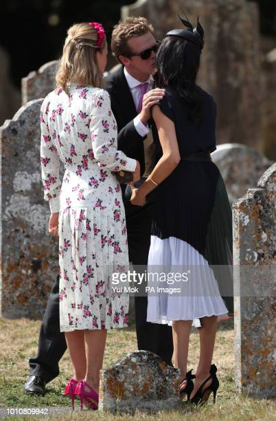 The Duchess of Sussex greets fellow guests as they arrive to attend the wedding of Charlie van Straubenzee and Daisy Jenks at St Mary the Virgin...