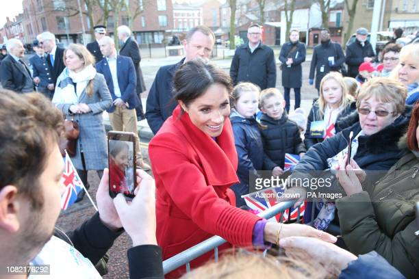The Duchess of Sussex meets members of the public on a visit to a new sculpture in Hamilton Square to mark the 100th anniversary of war poet Wilfred...