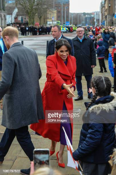"""The Duchess Of Sussex """"Meghan"""" seen greeting local school children during her official visit at Birkenhead. Meeting local school children and members..."""