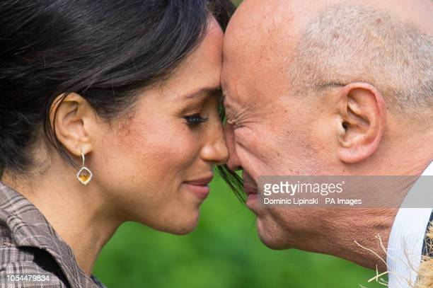The Duchess of Sussex performs a hongi as she attends an official welcome at Government House, in Wellington, on day one of the royal couple's tour...