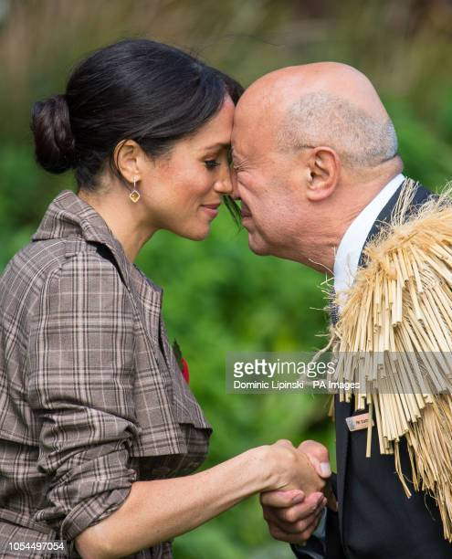 The Duchess of Sussex performs a hongi as she attends an official welcome at Government House in Wellington on day one of the royal couple's tour of...