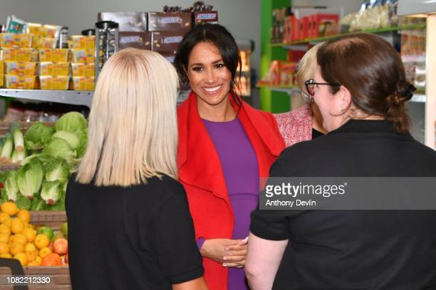 The Duchess of Sussex speaks with staff members as they officially open Number 7 a Feeding Birkenhead citizens supermarket and community cafe on...