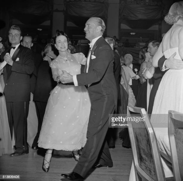 The Duchess of Windsor dances with Milton 'Doc' Holden a party being held in honour of the Duke and Duchess of Windsor at the Waldorf Astoria Park...