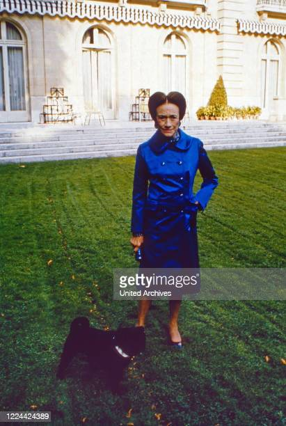 The Duchess of Windsor, Wallis Simpson, with her pug dogs at her home in Bois de Boulogne near Paris, France 1974.