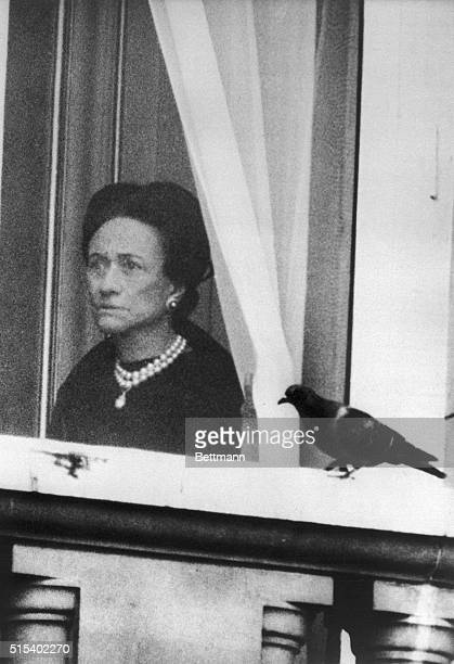 The Duchess of Windsor watches from the window of Buckingham Palace as Queen Elizabeth departs June 3rd for the Trooping of the Color ceremony The...