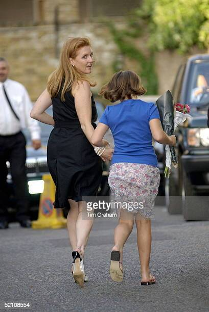 The Duchess Of York And Her Daughter Princess Eugenie Running From The Party To Be In Time To Watch A Performance At A School Concert After Society...
