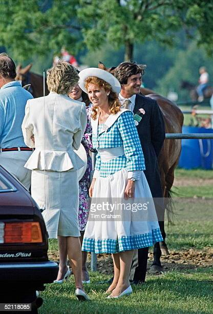 The Duchess Of York And The Princess Of Wales Stand Together Talking At A Polo Match In Windsor Berkshire with Oliver Hoare and wife Diane in...
