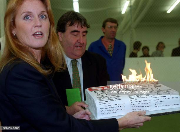 The Duchess of York receives a cake for her 40th birthday during the launch of the 1999/2000 Arena Cricket League at the Dummer Cricket Centre on her...