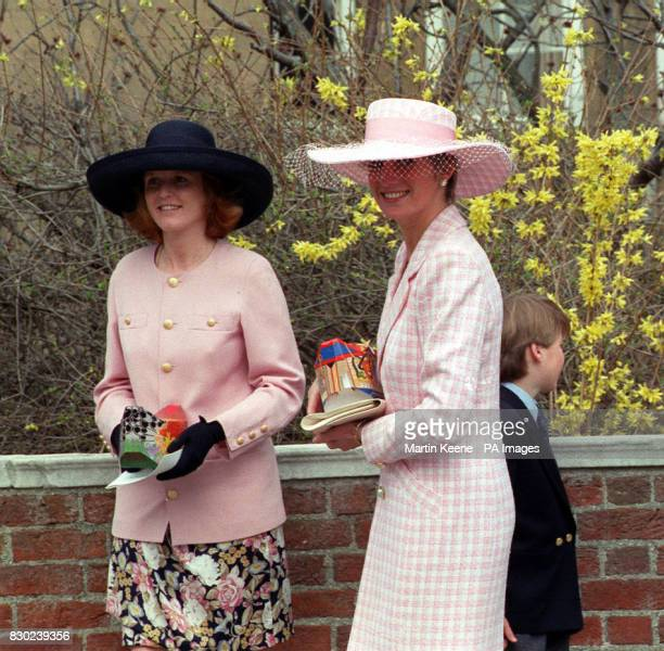 The Duchess of York Sarah Ferguson and Lady Diana the Princess of Wales holding Easter eggs after attending Morning Service at St George's Chapel in...