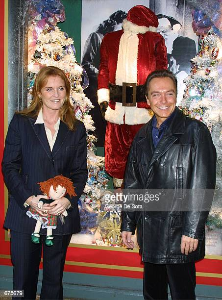 The Duchess of York Sarah Ferguson and singer David Cassidy attend an event to unveil the original Santa suit worn by Edmund Gwenn in the original...